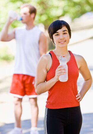 man drinking water: Runner drinking water