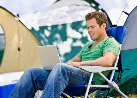 adventuresome: Camper using laptop