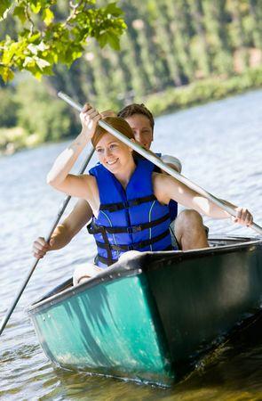 adventuresome: Couple rowing boat Stock Photo