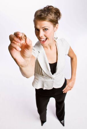 Businesswoman holding penny Imagens