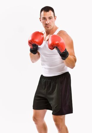 attired: Boxer in boxing gloves training Stock Photo