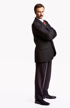 Stern businessman with arms crossed photo