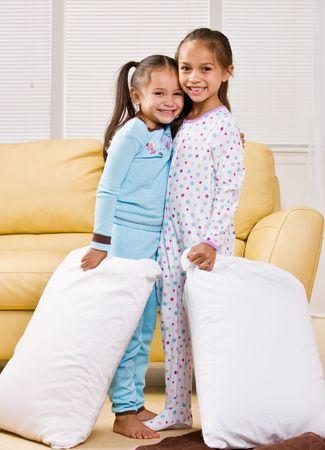 Girls in pajamas in livingroom 版權商用圖片