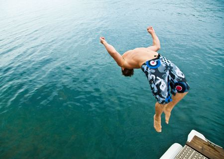 backflip: Man doing back-flip into lake