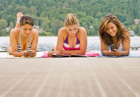 Friends laying on pier photo