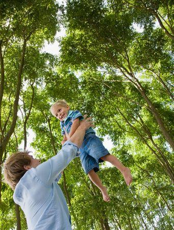 twenty two: Father lifting son outdoors Stock Photo