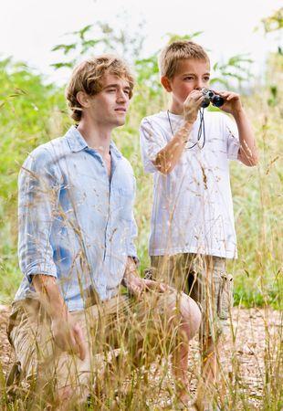 twenty two: Father and son using binoculars