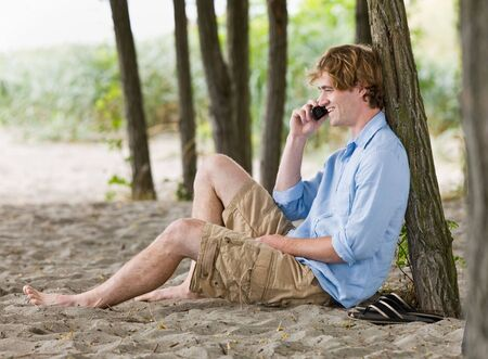 Man talking on cell phone outdoors photo