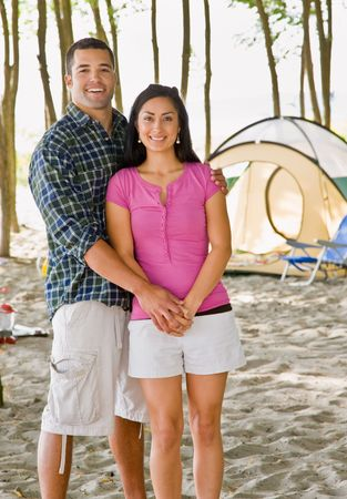 Couple holding hands at campsite Stock Photo - 6413479