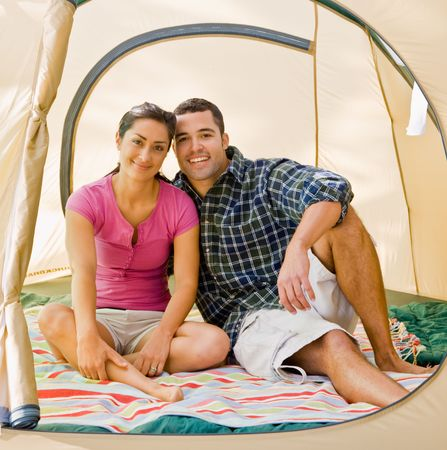 Couple sitting in tent Stock Photo - 6413693