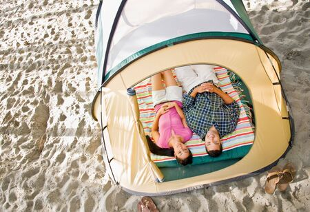 Couple laying in tent Stock Photo - 6413706