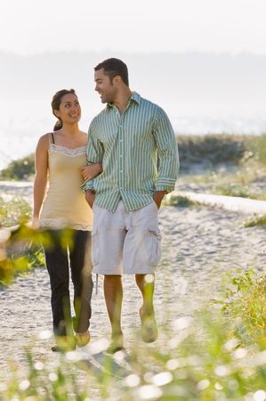 twenty two: Couple walking on beach Stock Photo