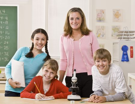 Teacher, students and microscope in classroom photo