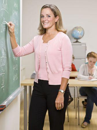 writing western: Teacher writing on blackboard