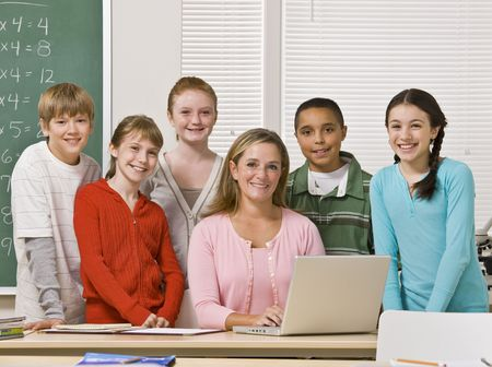 typist: Teacher posing with students