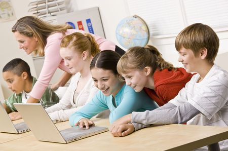 typist: Students working on laptops