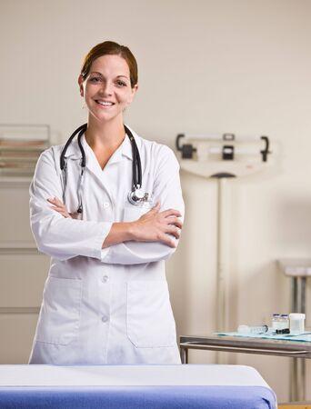 Doctor in lab coat in doctor office