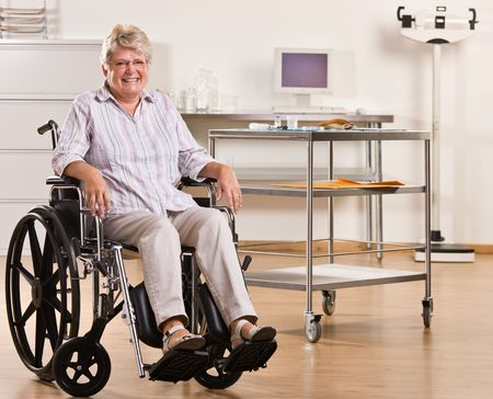 Senior woman sitting in wheelchair photo