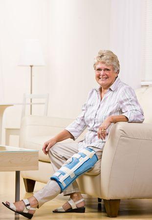 Senior woman wearing knee brace photo