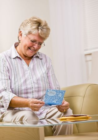 Senior woman reading note card photo