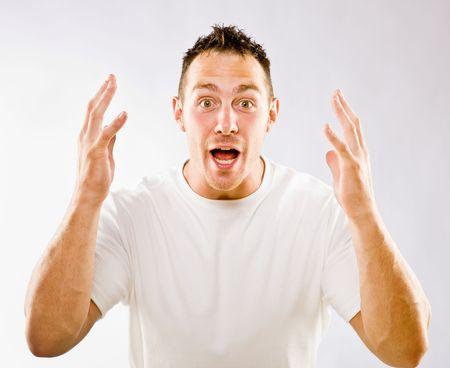 Man gesturing in surprise