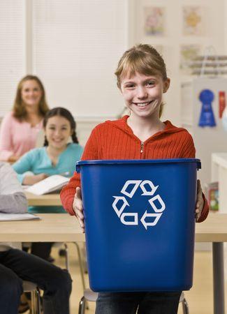 meticulous: Girl holding recycling bin