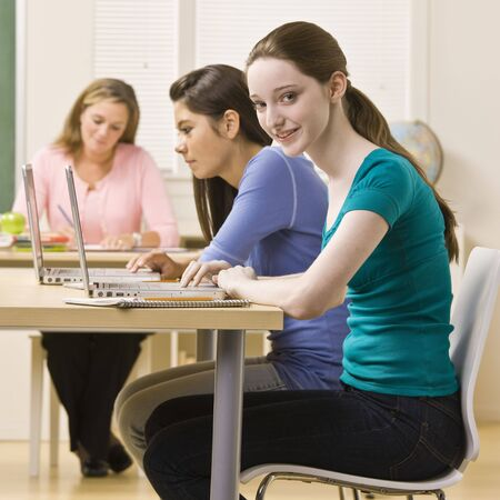 Students using laptops in classroom