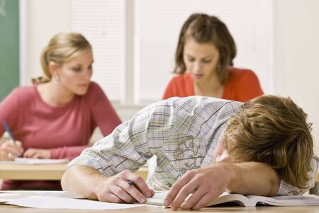 Student sleeping at desk in classroom Stock Photo - 6583179