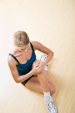 Woman stretching in health club Stock Photo - 6582307