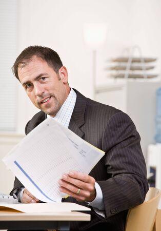 europeans: Businessman reviewing paperwork