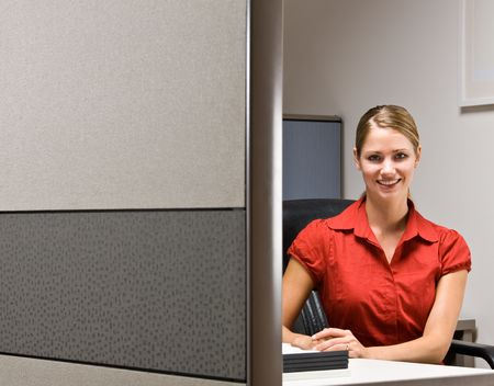 Businesswoman sitting at desk smiling photo