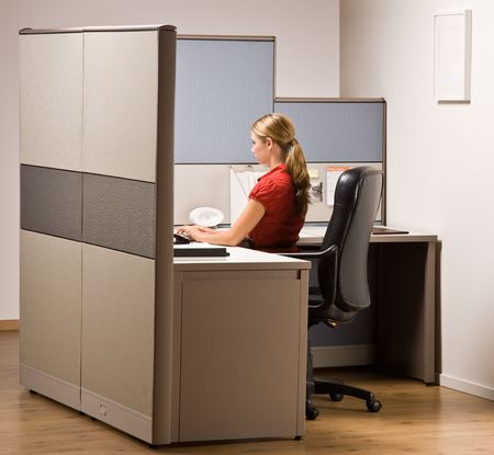 Businesswoman typing on computer at desk photo
