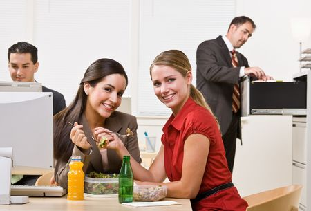 Businesswomen eating salad for lunch photo