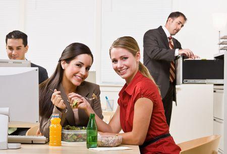 Businesswomen eating salad for lunch