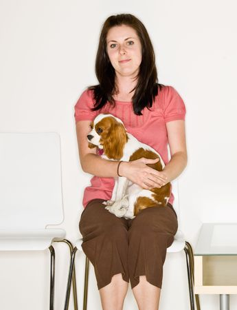 Woman holding dog in waiting room