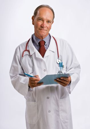 person writing: Doctor in lab coat and stethoscope Stock Photo
