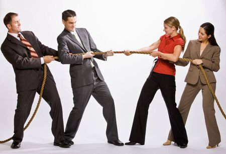 Business people playing tug-of-war Stock Photo - 6583432