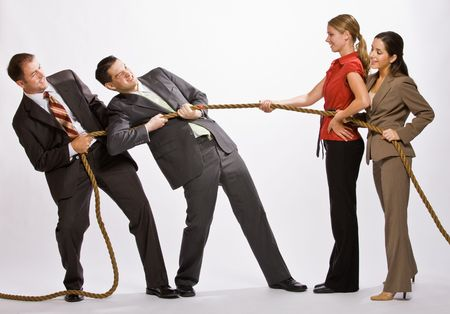 tugging: Business people playing tug-of-war Archivio Fotografico
