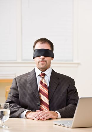 Businessman in blindfold photo