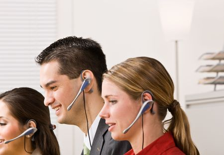 Business people talking on headsets photo