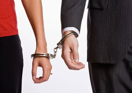 handcuffing: Business people handcuffed together