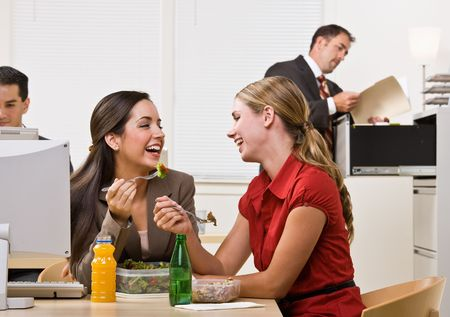 Businesswomen eating salad for lunch Stock Photo - 6583832