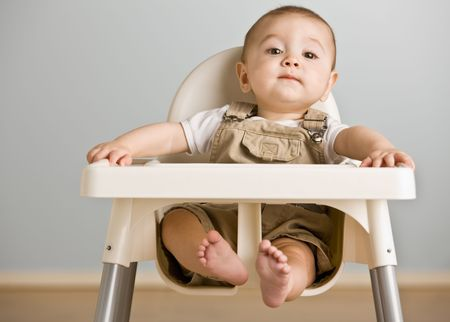 Baby sitting in highchair Stock Photo - 6583259