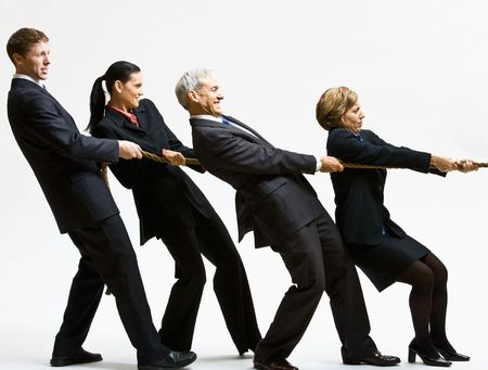 Business people playing tug-of-war Banque d'images