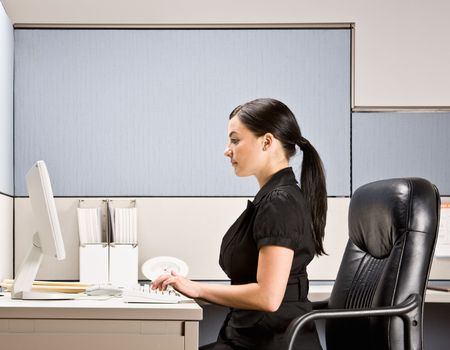europeans: Businesswoman typing on computer at desk