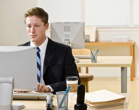 eager: Businessman working on computer