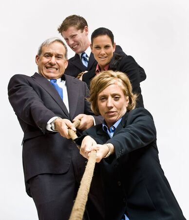 Business people playing tug-of-war photo