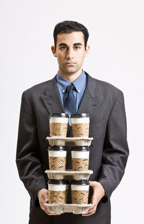 carrying: Businessman carrying stack of coffee cups