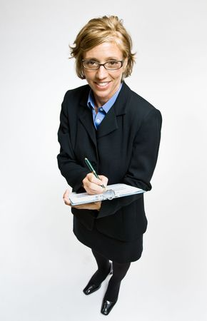 writing western: Businesswoman writing on clipboard