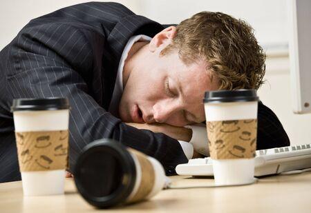 Businessman sleeping at desk